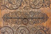 Intricate Vintage Wrought Iron Scroll Work On The Hinges On The Doors On The Facade Of Notre Dame De poster