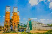 A concrete plant, also known as a batch plant or batching plant or a concrete batching plant. Large  poster