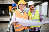 Construction Engineers Discussion With Architects At Construction Or Building Site poster