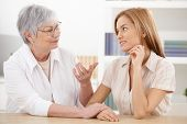foto of fondling  - Young woman visiting grandmother at home - JPG