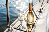 Romantic Luxury Evening On Cruise Yacht With Champagne Setting. Empty Glasses And Bottle With Champa poster