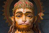 stock photo of hanuman  - Hanuman stone statue near Rishikesh in India - JPG