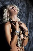 Topless Young Woman Blonde With Necklace In Erotic Pose Dreaming