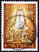 stock photo of fatima  - a stamp printed in the Portugal shows Apparition of Our Lady of Fatima - JPG