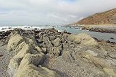 picture of mendocino  - A rocky beach off of Mattole Road on the Lost Coast of California with breaking surf and a cloudy sky - JPG