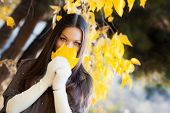 Girl Portrait In Autumn Garden