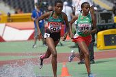 DONETSK, UKRAINE - JULY 12: Daisy Jepkemei, Kenya (left), and  Weynshet Ansa, Ethiopia compete in 2000 m steeplechase during 8th IAAF World Youth Championships in Donetsk, Ukraine on July 12, 2013