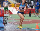 DONETSK, UKRAINE - JULY 12: Oksana Hach of Ukraine competes in 2000 m steeplechase during 8th IAAF W
