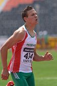 DONETSK, UKRAINE - JULY 12: Richard Kocse of Hungary competes in 200 metres during 8th IAAF World Youth Championships in Donetsk, Ukraine on July 12, 2013