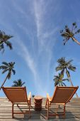 The excellent overview of the blue sky, white clouds and swaying palm trees. Two convenient comforta