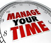 Manage Your Time words on a clock face to illustrate time management and using moments effectively t