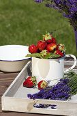 image of picking tray  - Fresh strawberries and freshly cut lavender lying on a wooden tray - JPG