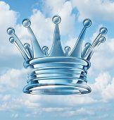 stock photo of three kings  - Leadership aspirations business concept and metaphor with a royal king crown floating in the sky as a success symbol of religion and faith in a leader of ideas and leading visionary providing guidance to a group of faithful followers - JPG