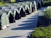 Several Large Military Tents On The Paved Area