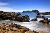 Long exposure image of the rocky coast and the islet of Vila Franca do Campo on Sao Miguel island, A