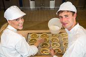 Bakers In Bakery Producing Pretzels