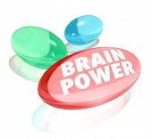 The words Brain Power on pills, capsules or vitamins to illustrate natural or alternative supplement to boost your mental capacity, memory or intelligence