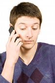 Casual Man Talking On A Mobile Phone Isolated Over White