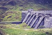 foto of hydro  - Hydro Power Dam In a Mountain Landscape - JPG