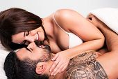 stock photo of flirt  - Love couple flirting and hugging in bed - JPG