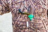 Hunter With Camouflage And Duck Calls