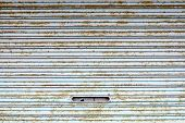 stock photo of louvers  - highly detailed striped rusty flickered louver background - JPG