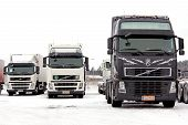 Group Of Volvo Trucks In Winter Conditions