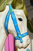 stock photo of carousel horse  - Cute carousel white horse head close up - JPG