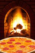 Pizza With Sausage And Open Fire In Oven