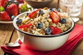 stock photo of cereal bowl  - Healthy Homemade Oatmeal with Berries for Breakfast - JPG