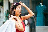 stock photo of jaw drop  - Jaw dropping woman looking amazed about shopping dress sales - JPG