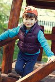Little Boy Outdoor In Cap