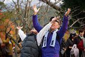 Kyoto,JAPAN, NOVEMBER 20 : Japanese people stretching our arms in adoration of Shinto gods, in Mount