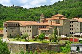 view of Virgen del Carmen Monastery in Boltanya, Huesca, Spain, and the small village in the background