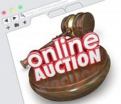 stock photo of bartering  - Online Auction 3d words with wood gavel on a website screen or internet website  - JPG