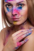 Beautiful Girl With Colour Powder On Face