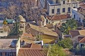 Greece, church domes and house roofs at Plaka old Athens center