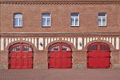 three red doors and four windows, firesquad station at Schkeuditz, Germany
