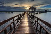 The Long Wooden Bridge During Sunset
