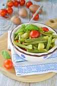 Summer potatoes salad with fresh green beans. Selective focus.