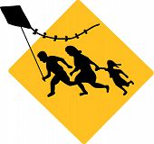 stock photo of deportation  - The running family flying a kite Banksy design - JPG