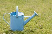 Small blue watering can