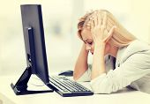 foto of pissed off  - picture of stressed businesswoman with computer at work - JPG