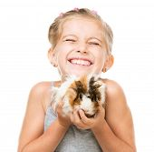 Cute little girl holding a guinea pig. Isolated on white background.