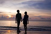 pic of sweethearts  - sunset silhouette of young couple in love at beach - JPG