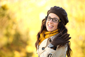 picture of waving hands  - Cheerful fashion woman waving - JPG