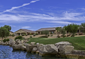 stock photo of curvy  - Homes and curvy landscape in a golfing community - JPG