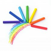 Kid's drawn rainbow and colorful crayons