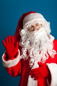 Santa Claus with red costume waving