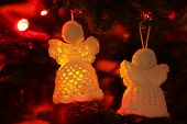 image of christmas angel  - Knitted Christmas angels on Christmas lights background - JPG